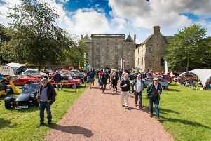 Bo'ness Revival  and Hill Climb. Spectators arrive as cars are on display in front of Kinneil House. Picture: Paul Cram.