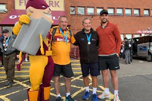 Motherwell captain Peter Hartley (1st right) was among those to greet charity walker Jeff Stelling when he arrived at Fir Park