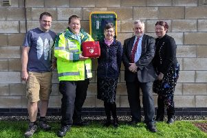 Two defibs have been installed via a collaboration with Mill Road Business Improvement District and Linlithgow 1st Responders. Left to right is Mark Darragh, owner of Playbugs and BID Chairman.  David Booth, Linlithgow 1st Responders. Jill Wardrobe, owner of Network Promotions, board member. Cllr Tom Conn, board member and west Lothian councillor and Sally McIntosh-Anderson.