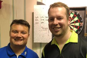 Ryan Hogarth, right, after his nine-dart leg during the Super League game in Hawick.