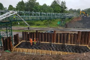 Work on the bridge, pictured in July.