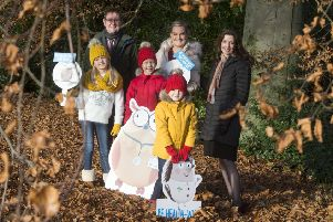 Nurse Lauren Kennedy and her three kids Eva, James and Calum, with Dr John MacAnaw, NHS 24, Head of Pharmacy and Dr Rose Marie Parr, Chief Pharmaceutical Officer, Scottish Government.
