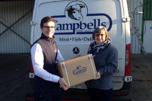 Alan Williamson from Campbells Prime Meats at Whitecross handing over the haggis to St.Michaels Church in Linlithgow, to be given to homeless people in Edinburgh.