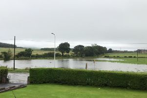 Flooding after heavy rain in August 2019 on the proposed site of a housing development on Kinglassie Road, Cardenden
