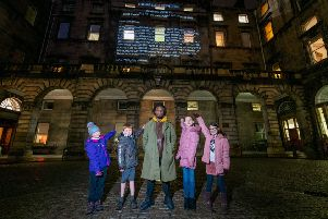 St Margaret's pupils Olivia Liddell, Josie Maxwell (right) with Kayus Bankole at Edinburgh City Chambers and the other winning pupils. Photo by Ian Georgeson.
