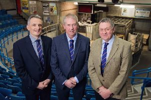 Norman Thow, centre, with ANM Group chief executive Grant Rogerson, left, and ANM Group chairman Pete Watson