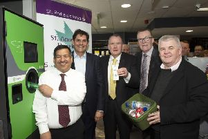 Nisa Local and Post Office owner Abdul Majid (left) is joined by Envipco president (l-r) Robert Lincoln, Richard Lyle MSP, Councillor Harry Curran and Hugh Gaffney MP to launch the reverse vending machine