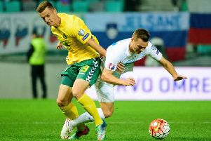 Falkirk's Deimantas Petravicius in action for  Lithuania (Pic: Jure Makovec/AFP/Getty Images)