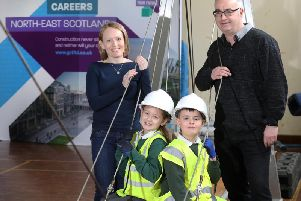 Michelle Forth of the Aberdeen Association of Construction Professionals and David Steel of Leiths with primary school pupils from Fernielea during the Bridge Building construction challenge