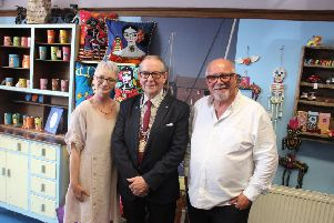 Aberdeenshire's deputy provost Ron McKail with Connects Trading Corner team members Adele Mackie and David Neill