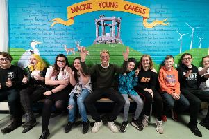 Russell Howard with young carers at Mackie Academy. Picture: Mandy Shannon
