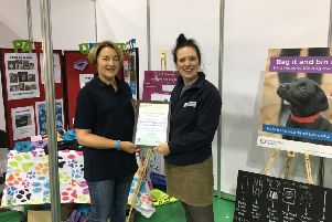 Marion Montgomery, left,  receives her award from Keep Scotland Beautiful's community project officer Heather McLaughlin