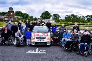 In the driving seat...more than 200 people have enjoyed free track days at Knockhill and Kames since Disability Motorsport Scotland was founded three years ago.