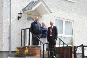 Melville's Neil Edgar and Andrew Noble, with Cathy Hanlan at her recently-insulated Easthouses home.