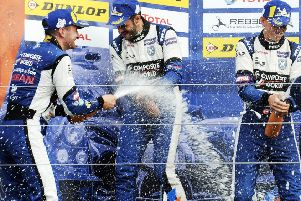 Noble left celebrates with team-mates after another podium finish