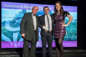 Kieran Rose, centre, receives his Thistle Award from Paul Bush, of VisitScotland, and regional final host Jennifer Reoch.