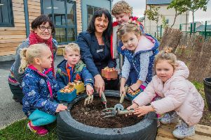 (left to right) Karen McKnight (Class Teacher) and Natalie Lewis, Sales Executive for Taylor Wimpey join children from Burnbrae Primary to plant spring bulbs as part of Taylor Wimpey's national Proud campaign.