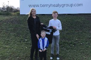 Terry Healy Group sponsor Newtongrange Star Youth Academy, Gayle Anderson, director of Terry Healy Group, Aaron Healy and an academy team captain