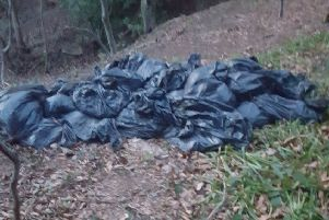 Bags that have been dumped on  the banks of the Mary Burn,  full of wet wipes, face  wipes and sanitary towels.