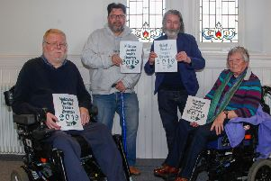 L to R:  Jeff Adamson, Graham Thomson, Eric Johnstone and Marlene Gill with the new directory.