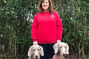 Catherine with her two dogs Roxy and Riley