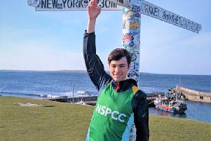 Jack Lancefield at the  John O'Groats sign