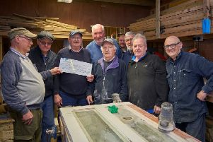 Mayfield and Easthouses Men's Shed receiving a donation from Specialist Joinery Fittings.
