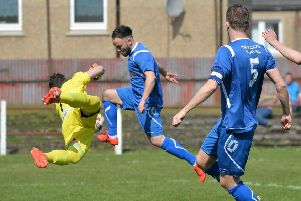 Fraser Keast (Bo'ness) beats Haris Alysandratos (Tranent keeper) for the first goal.''(pic) Dave Johnston