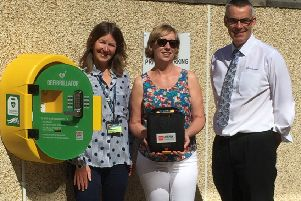Dalkeith's first 24 hour lifesaving defribrillator unveiled. Photo shows (left to right) PC Rona Duncan Police Scotland Communities Officer, Evelyn Fleck from Dalkeith and District Community Council and Andrew Noble Chief Executive of Melville Housing Association.
