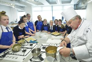 Apex Hotels' Head Chef for Education, John Newton on a visit to Newbattle Community High School to teach pupils cookery skills. � Sandy young Photography