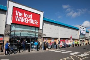 Shoppers queue outside the Food Warehouse at Straiton Retail Park.