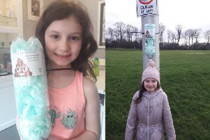 Isla Mackenzie has been putting up plastic bottles around her estate in Easter Langside Dalkeith as dog poo bag dispensers.