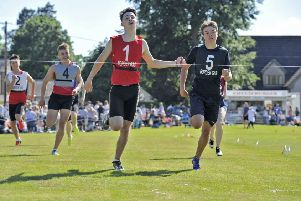 Selkirk games. Douglas Young of Kelso in bib number one wins the 200mtrs Youth Group 'A' final.