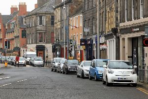Parked cars on Dalkeith High Street, pictured before the three new Midlothian parking wardens were introduced in April last year.