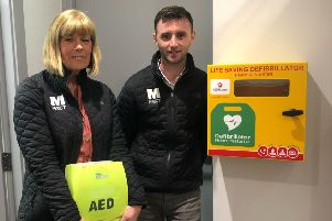 M-Pact Group staff Yvonne Jack, HR Manager and Sean Coleman, Contracts Manager, with the defib machine.