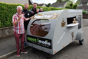 Jamie Callaghan and Martin Jackson are taking part in a soapbox race to raise money for The Driving Force. They are pictured with David McMillan, chairman of The Driving Force. Picture: Michael Gillen