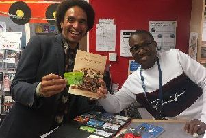 Pictured at Danderhall Library is renowned poet and writer Joseph Coelho, with library assistant Chukwuka Ododo.