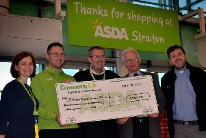 Gordon MacDonald and the Rev John Urquhart of St Mungo's Church in Penicuik are presented with the  cheque by Asda's Frances Davies, Fabiano Furlan and Brian Boyle