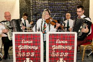 The Ewan Galloway Scottish Dance Band, led by Ewan from Dalkeith,  pictured on the right hand side(red trousers) playing accordion.