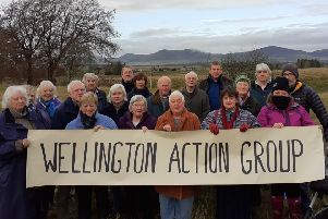 Members of the Wellington Action Group, at the site of the former Wellington School in Penicuik.