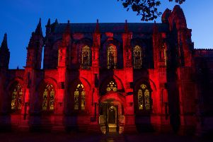 Rosslyn Chapel is being lit red every evening, in support of the Scottish Poppy Appeal. Photo by Rob McDougall.