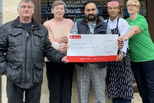 Left to right:  Carole O'Reilly,  her husband Bill, Radhuni managing partner Habibur Khan, head chef Ashok Ram and Elaine Gordon from Macmillan.