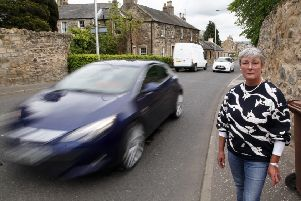 Petitioner Fiona Gilbert, pictured next to the busy road in Bonnyrigg.