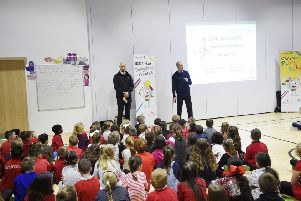Pic - Greg Macvean - Adam Smith (Senior Site Manager) & Stewart Ponton (Safety, Health and Environment Manager for Barratt Developments PLC) delivering the site safety presentation to Paradykes Primary Pupils.