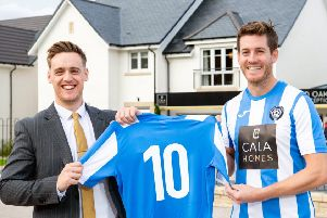 Belwood Oaks Sales Advisor Blair Dickson and Penicuik Athletic captain Aaron somerville.' CALA Homes has sponsored the local team for 10 years in a row.