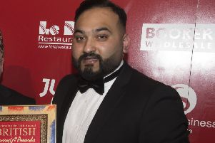 Habibur Khan,  pictured with one of the many awards The Radhuni in Loanhead has received.