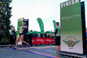 Sarah Inglis crosses the line to win the St Patrick's Day race in Stanley Park in Vancouver. (pic by Gregory Lienert Photography)