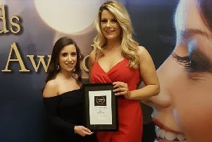 Olivia Summers and Demi Brown of Sheer Beauty with their award