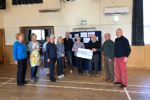 Rob and Jess Gibb present their cheque to transport group members