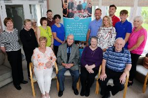 Kevin Beattie with friends and family 'Paying for the Day' at Strathcarron Hospice in memory of Jane Campbell.  Pic: Michael Gillen.